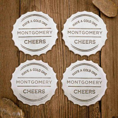 Crafting Memories Coaster Set on wood background, includes 4 pewter coasters