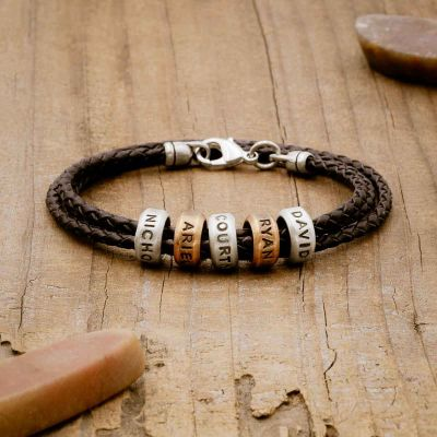 Limitless Leather bracelet handcrafted with black bolo leather cord and choice of personalized sterling silver and bronze limitless rings